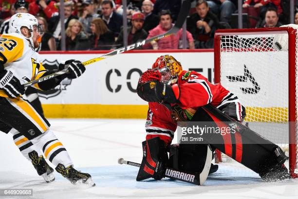 Scott Wilson of the Pittsburgh Penguins scores on goalie Scott Darling of the Chicago Blackhawks in the second period at the United Center on March 1...