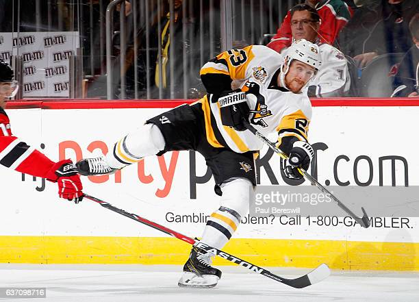 Scott Wilson of the Pittsburgh Penguins shoots the puck during an NHL hockey game against the New Jersey Devils at Prudential Center on December 27...