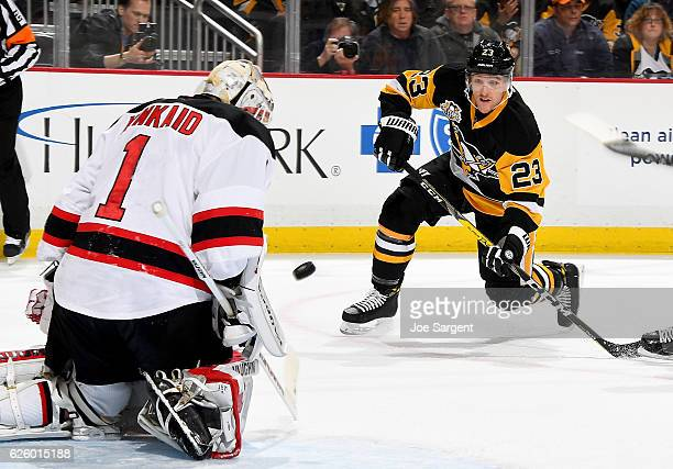 Scott Wilson of the Pittsburgh Penguins takes a shot on goal against Keith Kinkaid of the New Jersey Devils at PPG Paints Arena on November 26 2016...