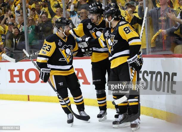 Scott Wilson Phil Kessel and Evgeni Malkin of the Pittsburgh Penguins celebrate with Ron Hainsey after Hainsey scored the sixth Penguins goal during...