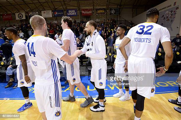 Scott Wood and Mychel Thompson and the Santa Cruz Warriors celebrate after their win against the Iowa Energy on November 16 2016 at Kaiser Permanente...