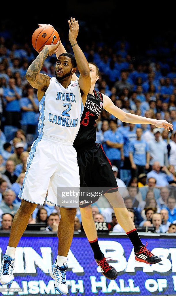 Scott Wood #15 of the North Carolina State Wolfpack blocks a shot by Leslie McDonald #2 of the North Carolina Tar Heels during play at the Dean Smith Center on February 23, 2013 in Chapel Hill, North Carolina. North Carolina won 76-65.