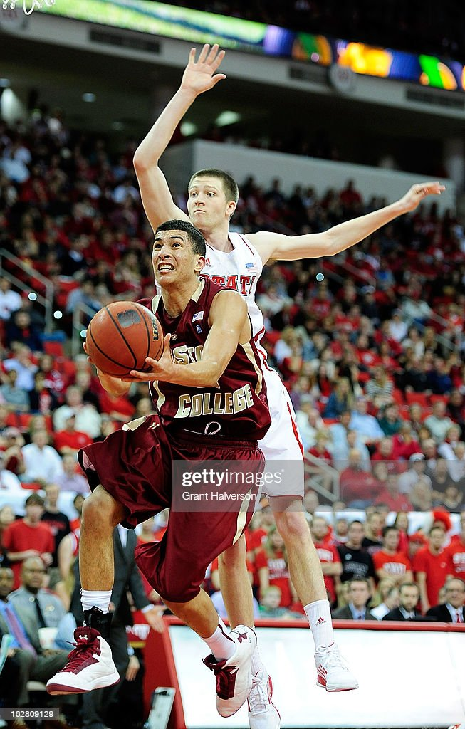 Scott Wood #15 of the North Carolina State Wolfpack defends a shot by Lonnie Jackson #20 of the Boston College Eagles during play at PNC Arena on February 27, 2013 in Raleigh, North Carolina. North Carolina State won 82-64.