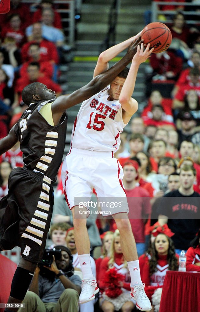 Scott Wood #15 of the North Carolina State Wolfpack takes a rebound away from Youssou Ndoye #35 of the St. Bonaventure Bonnies during play at PNC Arena on December 22, 2012 in Raleigh, North Carolina. North Carolina State won 92-73.