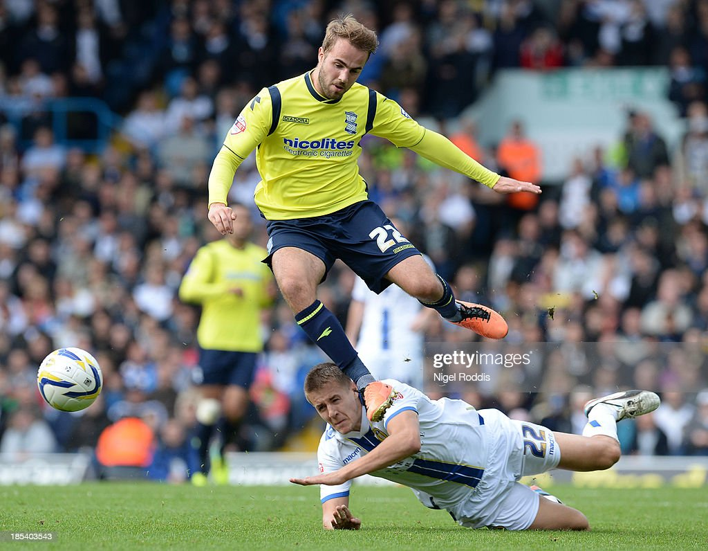 Scott Wooton (R) of Leeds United challenges Andrew Shinnie of Birmingham City during their Sky Bet Championship match between Leeds United and Birmingham City at Elland Road Stadium on October 20, 2013 in Leeds, England.