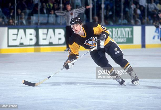 Scott Young of the Pittsburgh Penguins skates on the ice during an NHL preseason game against the New York Islanders in September 1990 at the Nassau...