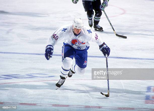 Scott Young of the Quebec Nordiques skates with the puck during an NHL game against the Hartford Whalers on February 5 1995 at the Quebec Coliseum in...