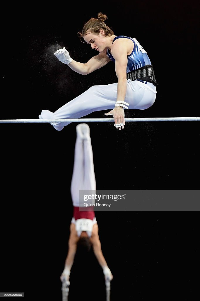 Scott Young of Victoria competes on the high bar as Jean Nick of Queensland competes on the parrallel bars during the 2016 Australian Gymnastics Championships at Hisense Arena on May 23, 2016 in Melbourne, Australia.