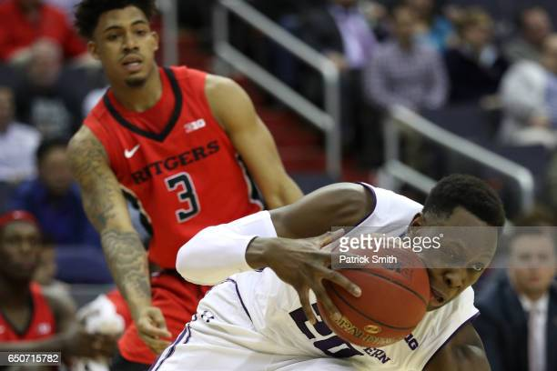 Scottie Lindsey of the Northwestern Wildcats dribbles past Corey Sanders of the Rutgers Scarlet Knights during the first half in the second round of...