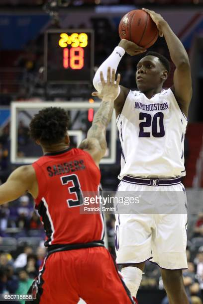 Scottie Lindsey of the Northwestern Wildcats shoots in front of Corey Sanders of the Rutgers Scarlet Knights during the first half in the second...