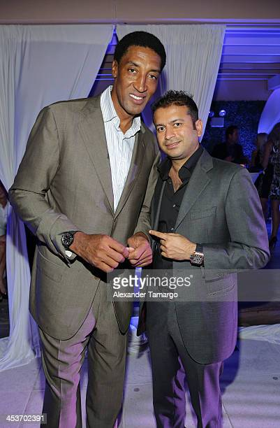 Scottie Pippen and Kamal Hotchandani pose at the Haute Living OMEGA Dark Side of the Moon Watch event hosted by Larsa and Scottie Pippen on December...