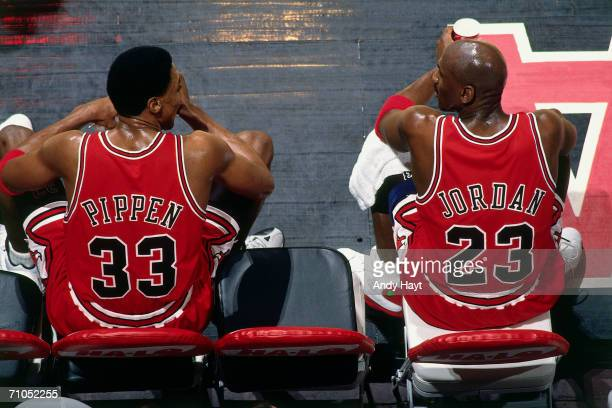 Scottie Pippen and Michael Jordan of the Chicago Bulls sit on the bench during the game against the Vancouver Grizzlies at General Motors Place on...