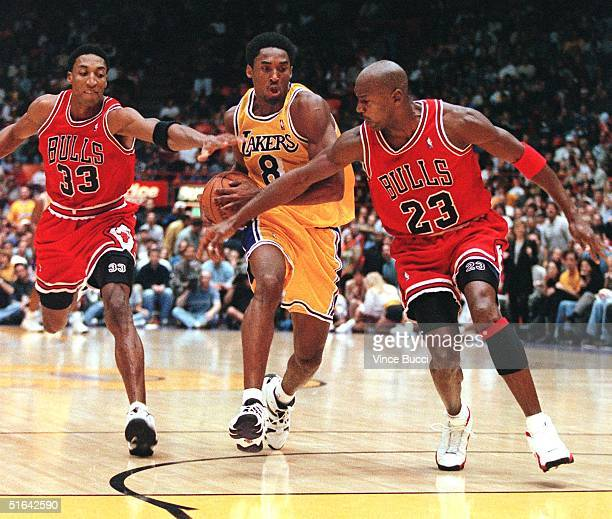 Scottie Pippen and Michael Jordan of the Chicago Bulls try to stop Kobe Bryant of the Los Angeles Lakers as he leads a fast break during their 01...