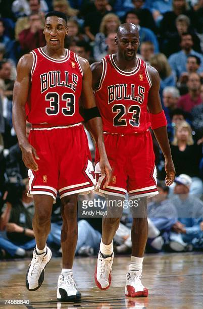 Scottie Pippen and Michael Jordan of the Chicago Bulls walk upcourt during a 1997 NBA game at the Delta Center in Salt Lake City Utah NOTE TO USER...