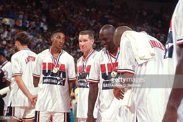 Scottie Pippen Chris Mullin Michael Jordan and Charles Barkley laugh following the Gold Medal Basketball game between the United States and Croatia...