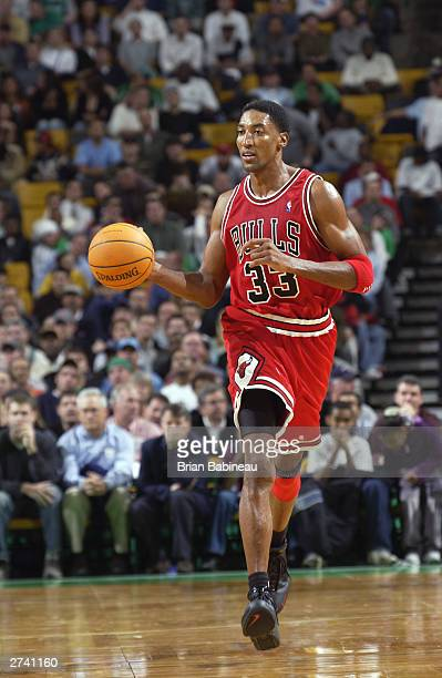 Scottie Pippen of the Chicago Bulls drives against the Boston Celtics during the game at Fleet Center on November 12 2003 in Boston Massachusetts The...