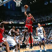 Scottie Pippen of the Chicago Bulls dunks against Karl Malone of the Utah Jazz during Game Two of the 1998 NBA Finals at the Delta Center on June 5...