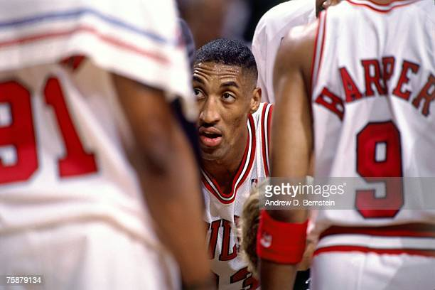 Scottie Pippen of the Chicago Bulls listens in a team huddle during a 1996 NBA game at the United Center in Chicago Illinois NOTE TO USER User...