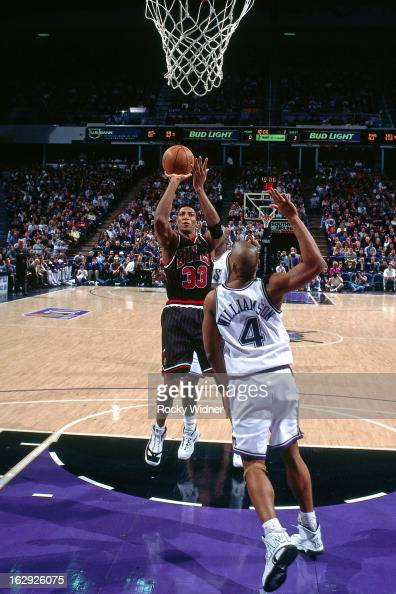Scottie Pippen of the Chicago Bulls shoots against Corliss Williamson of the Sacramento Kings during a game played on January 30 1997 at Arco Arena...