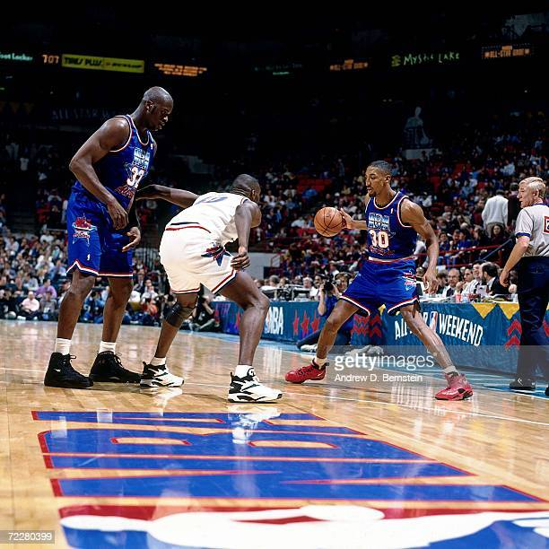 Scottie Pippen of the Eastern Conference All Stars dribbles against Shawn Kemp of the Western Conference All Stars during the 1994 NBA All Star Game...