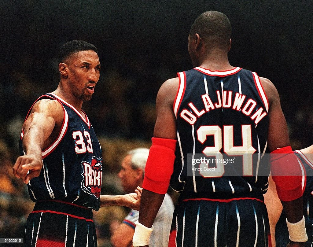 Scottie Pippen of the Houston Rockets L talks wi