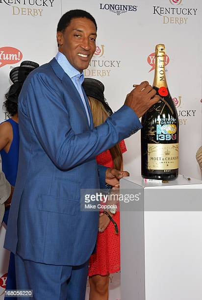 Scottie Pippin signs the Moet Chandon 6L for the Churchill Downs Foundation during the Kentucky Derby at Churchill Downs on May 4 2013 in Louisville...