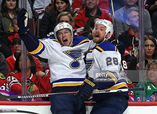 Scottie Upshall and Kyle Brodziak of the St Louis Blues celebrate Upshall's first period goal against the Chicago Blackhawks in Game Six of the...