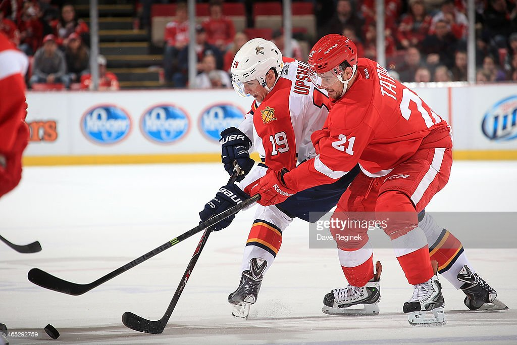 <a gi-track='captionPersonalityLinkClicked' href=/galleries/search?phrase=Scottie+Upshall&family=editorial&specificpeople=209198 ng-click='$event.stopPropagation()'>Scottie Upshall</a> #19 of the Florida Panthers and <a gi-track='captionPersonalityLinkClicked' href=/galleries/search?phrase=Tomas+Tatar&family=editorial&specificpeople=5652303 ng-click='$event.stopPropagation()'>Tomas Tatar</a> #21 of the Detroit Red Wings battle for the puck during an NHL game on January 26, 2014 at Joe Louis Arena in Detroit, Michigan. Florida defeated Detroit 5-4 in a shootout.