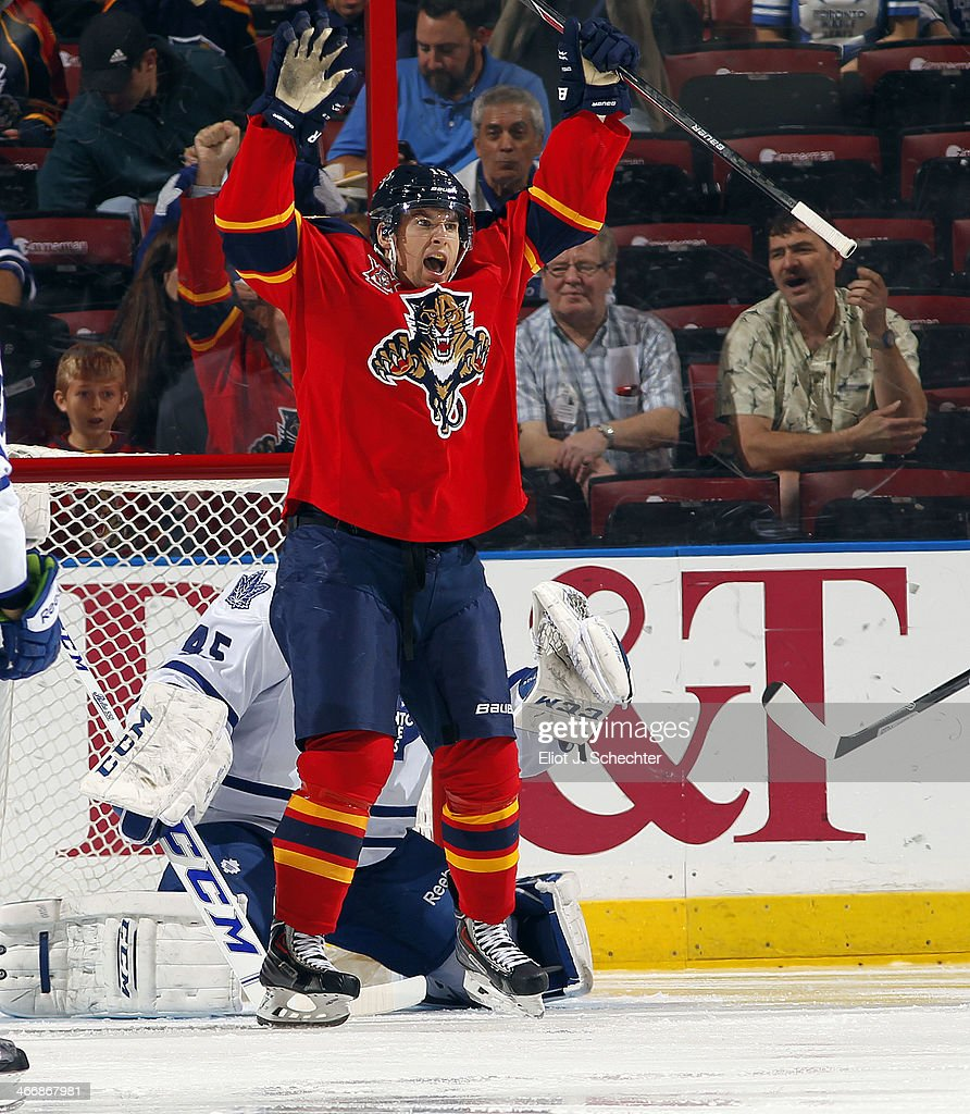 Scottie Upshall #19 of the Florida Panthers celebrates a goal by teammate Tom Gilbert (not pictured) against the Toronto Maple Leafs at the BB&T Center on February 4, 2014 in Sunrise, Florida.