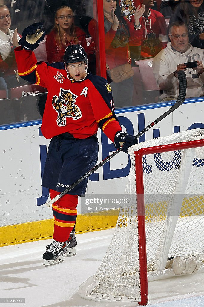 <a gi-track='captionPersonalityLinkClicked' href=/galleries/search?phrase=Scottie+Upshall&family=editorial&specificpeople=209198 ng-click='$event.stopPropagation()'>Scottie Upshall</a> #19 of the Florida Panthers celebrates his goal against the New York Rangers at the BB&T Center on November 27, 2013 in Sunrise, Florida.