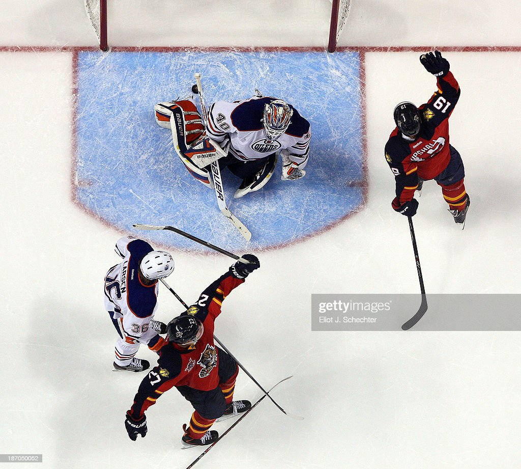 <a gi-track='captionPersonalityLinkClicked' href=/galleries/search?phrase=Scottie+Upshall&family=editorial&specificpeople=209198 ng-click='$event.stopPropagation()'>Scottie Upshall</a> #19 of the Florida Panthers celebrates his goal to tie the game against Goaltender <a gi-track='captionPersonalityLinkClicked' href=/galleries/search?phrase=Devan+Dubnyk&family=editorial&specificpeople=2089794 ng-click='$event.stopPropagation()'>Devan Dubnyk</a> #40 of the Edmonton Oilers at the BB&T Center on November 5, 2013 in Sunrise, Florida.