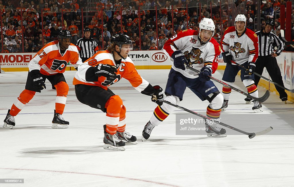 <a gi-track='captionPersonalityLinkClicked' href=/galleries/search?phrase=Scottie+Upshall&family=editorial&specificpeople=209198 ng-click='$event.stopPropagation()'>Scottie Upshall</a> #19 of the Florida Panthers clears the puck in front of <a gi-track='captionPersonalityLinkClicked' href=/galleries/search?phrase=Claude+Giroux&family=editorial&specificpeople=537961 ng-click='$event.stopPropagation()'>Claude Giroux</a> #28 of the Philadelphia Flyers at the Wells Fargo Center on October 8, 2013 in Philadelphia, Pennsylvania.