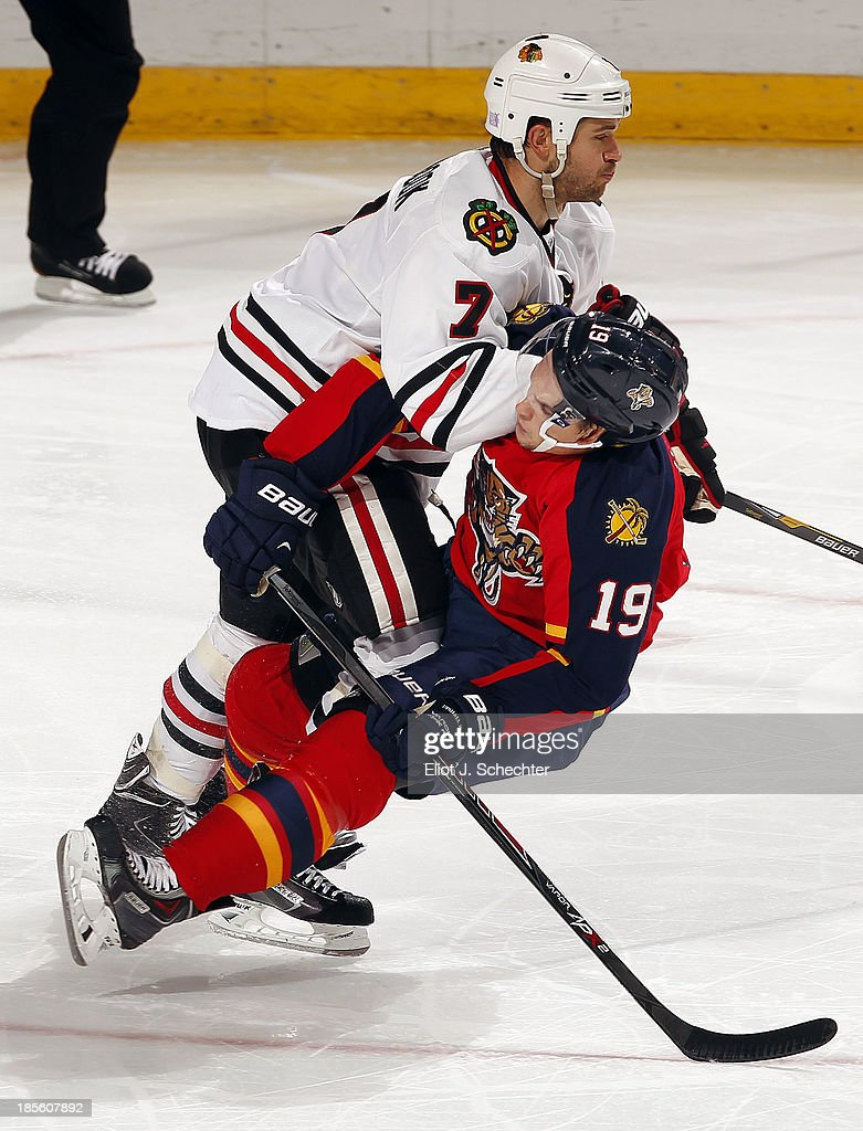 <a gi-track='captionPersonalityLinkClicked' href=/galleries/search?phrase=Scottie+Upshall&family=editorial&specificpeople=209198 ng-click='$event.stopPropagation()'>Scottie Upshall</a> #19 of the Florida Panthers collides with <a gi-track='captionPersonalityLinkClicked' href=/galleries/search?phrase=Brent+Seabrook&family=editorial&specificpeople=638862 ng-click='$event.stopPropagation()'>Brent Seabrook</a> #7 of the Chicago Blackhawks at the BB&T Center on October 22, 2013 in Sunrise, Florida.