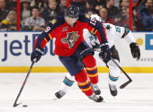 Scottie Upshall of the Florida Panthers skates with the puck against James Sheppard of the San Jose Sharks at the BBT Center on January 16 2014 in...