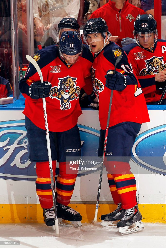 Scottie Upshall #19 of the Florida Panthers talks with teammate Jonathan Huberdeau #11 during a break in the action against the Toronto Maple Leafs at the BB&T Center on February 4, 2014 in Sunrise, Florida.