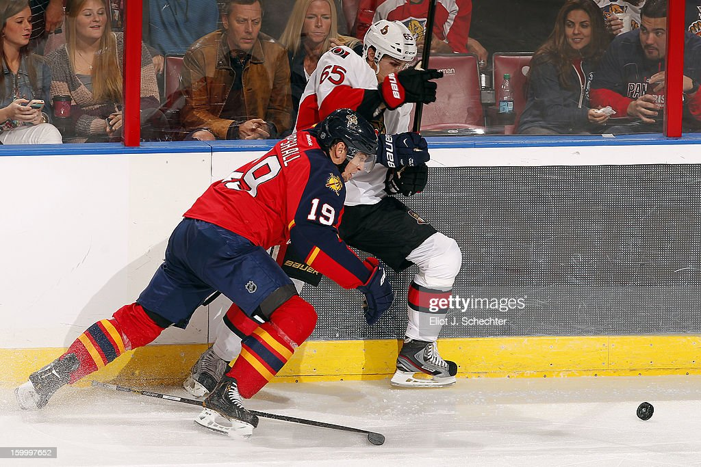 <a gi-track='captionPersonalityLinkClicked' href=/galleries/search?phrase=Scottie+Upshall&family=editorial&specificpeople=209198 ng-click='$event.stopPropagation()'>Scottie Upshall</a> #19 of the Florida Panthers tangles with <a gi-track='captionPersonalityLinkClicked' href=/galleries/search?phrase=Erik+Karlsson&family=editorial&specificpeople=5370939 ng-click='$event.stopPropagation()'>Erik Karlsson</a> #65 of the Ottawa Senators at the BB&T Center on January 24, 2013 in Sunrise, Florida.