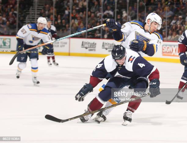 Scottie Upshall of the St Louis Blues battles for positions against Tyson Barrie of the Colorado Avalanche at the Pepsi Center on March 31 2017 in...