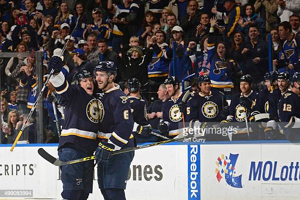 Scottie Upshall of the St Louis Blues celebrates with Joel Edmundson after scoring a game winning goal against the Columbus Blue Jackets on November...