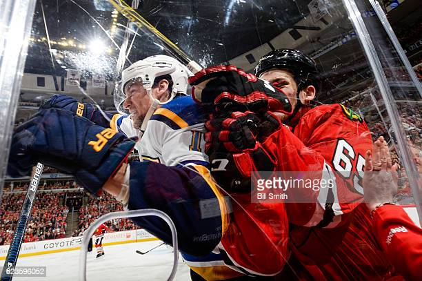 Scottie Upshall of the St Louis Blues checks Andrew Shaw of the Chicago Blackhawks into the glass in the second period of Game Six of the Western...