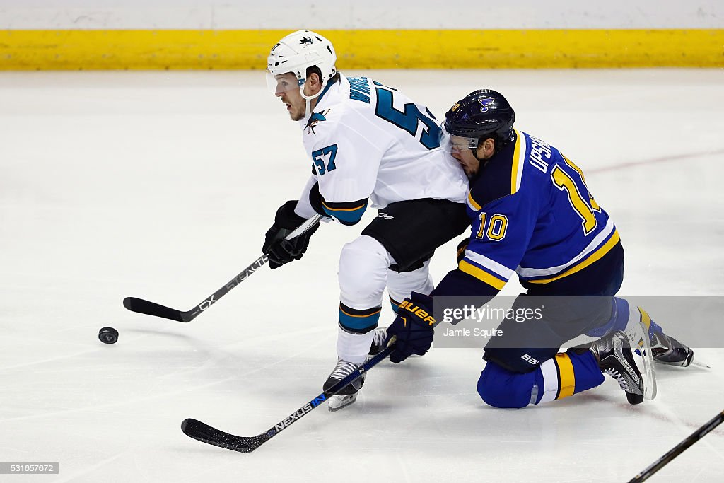 Scottie Upshall #10 of the St. Louis Blues collides with Tommy Wingels #57 of the San Jose Sharks during the first period in Game One of the Western Conference Final during the 2016 NHL Stanley Cup Playoffs at Scottrade Center on May 15, 2016 in St Louis, Missouri.