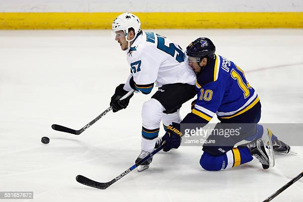 Scottie Upshall of the St Louis Blues collides with Tommy Wingels of the San Jose Sharks during the first period in Game One of the Western...