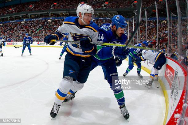 Scottie Upshall of the St Louis checks Blues Erik Gudbranson of the Vancouver Canucks during their NHL game at Rogers Arena November 18 2017 in...
