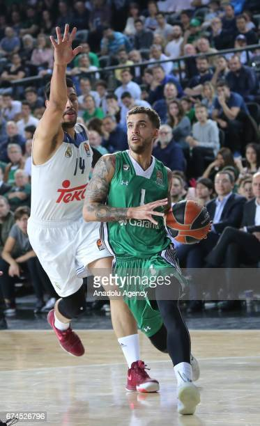 Scottie Wilbekin of Darussafaka Dogus in action against Gustavo Ayon of Real Madrid during the Turkish Airlines EuroLeague Playoffs Game 4 between...