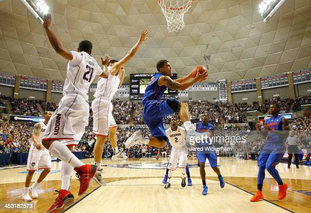 Scottie Wilbekin of the Florida Gators attempts a layup underneath the basket against the Connecticut Huskies in the second half during the game at...