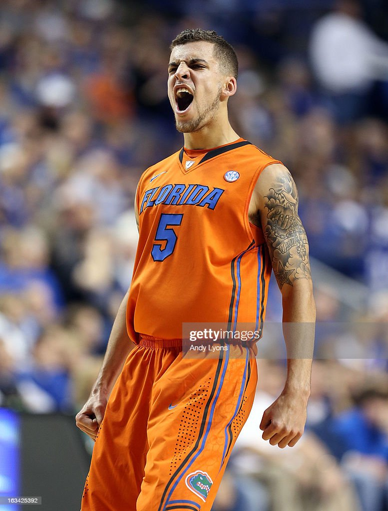 Scottie Wilbekin #5 of the Florida Gators celebrates during the game against the Kentucky Wildcats at Rupp Arena on March 9, 2013 in Lexington, Kentucky.