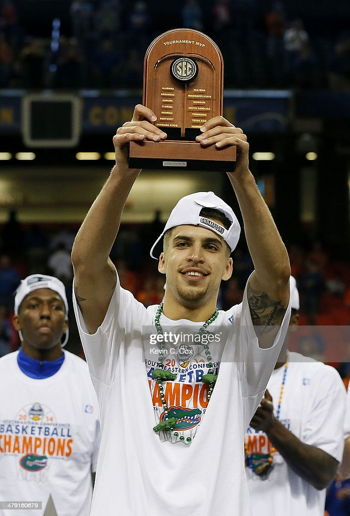 Scottie Wilbekin of the Florida Gators celebrates with the MVP trophy after their 61 to 60 win over the Kentucky Wildcats in the Championship game of...