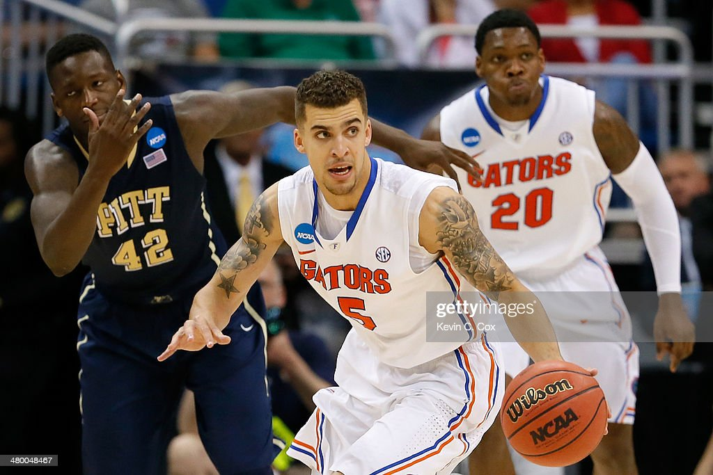 Scottie Wilbekin of the Florida Gators dribbles the ball against the Pittsburgh Panthers in the second half during the third round of the 2014 NCAA...