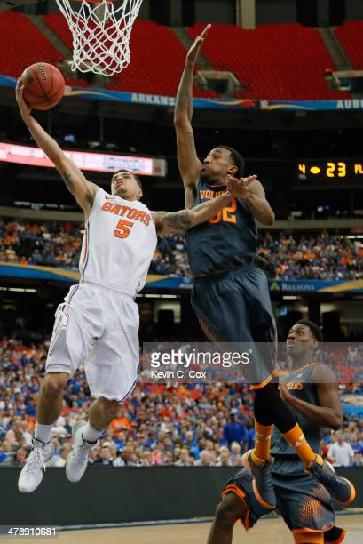 Scottie Wilbekin of the Florida Gators goes up for a shot against Jordan McRae of the Tennessee Volunteers during the semifinals of the SEC Men's...