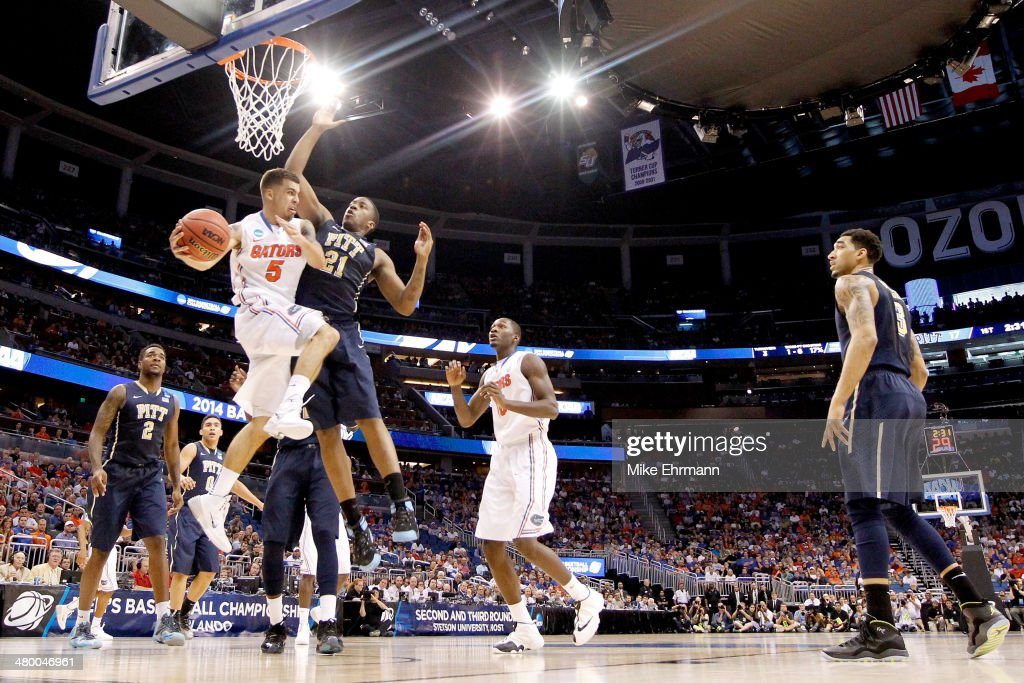 Scottie Wilbekin of the Florida Gators looks to pass against Lamar Patterson of the Pittsburgh Panthers in the first half during the third round of...
