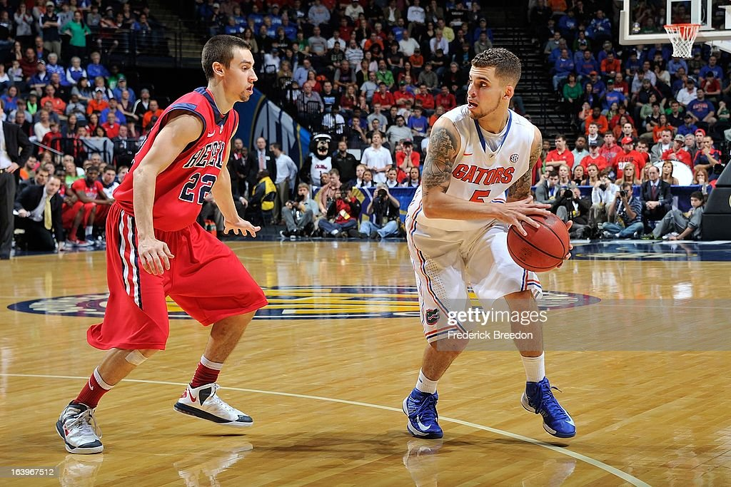Scottie Wilbekin #5 of the Florida Gators plays against Marshall Henderson #22 of the Ole Miss Rebels during the SEC Baskebtall Tournament Championship Game at Bridgestone Arena on March 17, 2013 in Nashville, Tennessee.